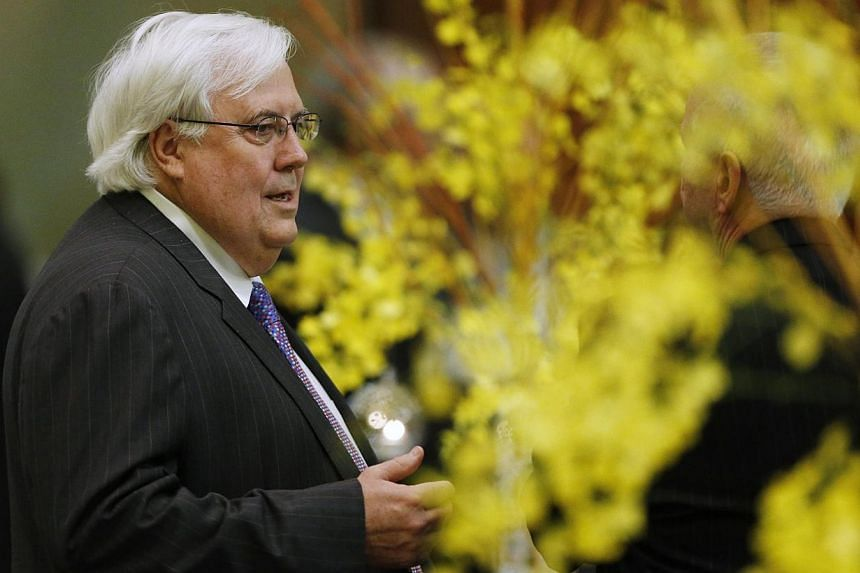Australian Politician Clive Palmer is pictured during a dinner hosted for Japan's Prime Minister Shinzo Abe at Parliament House in Canberra, on July 8, 2014.It took mining magnate Clive Palmer only three days to show Australian Prime Minister T