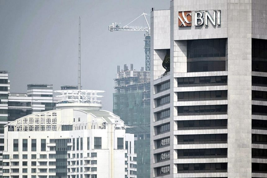 Buildings in the capital city Jakarta on June 12, 2014. A new draft of Indonesia's banking bill has revealed that lawmakers will proceed with a plan to restrict the operation of foreign banks, setting a deadline for them to become legal entities in t