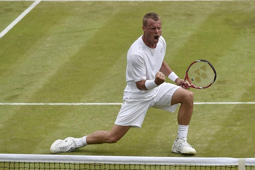 Lleyton Hewitt of Australia celebrates winning the fourth set during his men's singles match against Jerzy Janowicz of Poland at the Wimbledon Tennis Championships, in London on June 27, 2014. Former world number one Lleyton Hewitt defeated seco