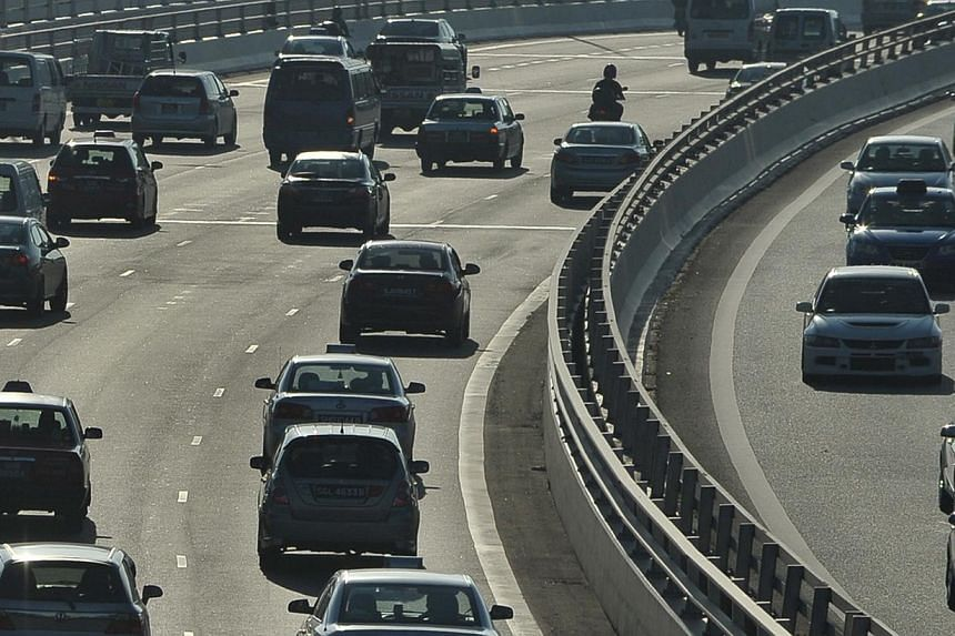 Morning rush-hour traffic on the Pan-Island Expressway (PIE). Some budget cars could be classified as premium models when a new rule is introduced. -- ST PHOTO: ALPHONSUS CHERN