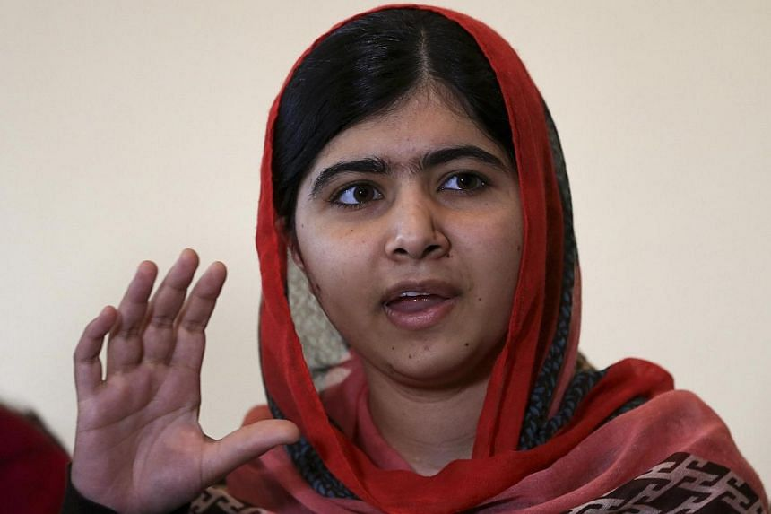 Pakistani schoolgirl activist Malala Yousafzai speaks during a meeting with the leaders of the #BringBackOurGirls Abuja campaign group, in Abuja July 13, 2014.Pakistani rights activist Malala Yousafzai, who survived being shot in the head by th