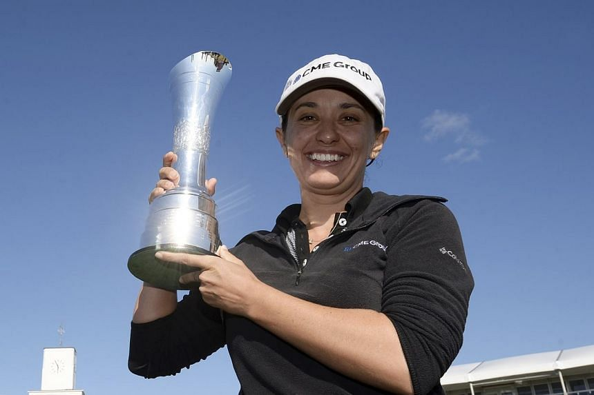 Mo Martin of the U.S. poses for photographs after winning the women's British Open golf tournament at the Royal Birkdale Golf Club in Southport, northern England, on July 13, 2014. Mo Martin continued a run of American victories in the women's m