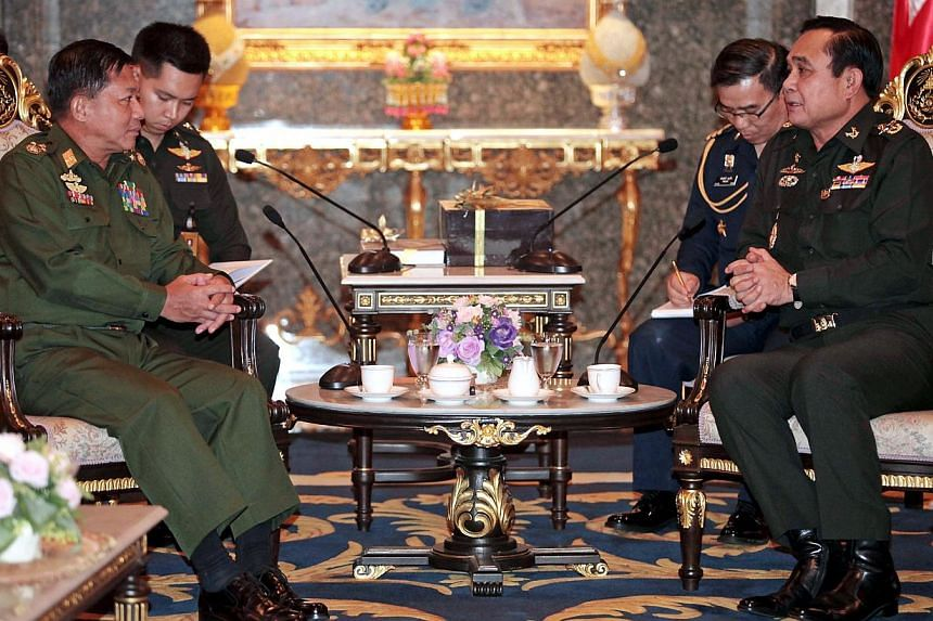 This handout photo taken on July 4, 2014 shows Thai coup leader and army chief General Prayut Chan-O-Cha (R) talking with Myanmar Supreme Commander Senior General Min Aung Hlaing (L) at the Army headquarter in Bangkok. Min Aung Hlaing was visiting Th