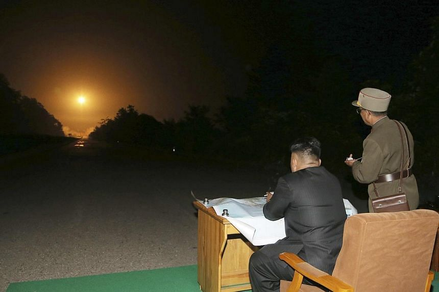 North Korean leader Kim Jong Un provides field guidance during a tactical rocket firing drill carried out by units of the Korean People's Army (KPA) Strategic Force in the western sector of the front in this undated photo released by North Korea's Ko