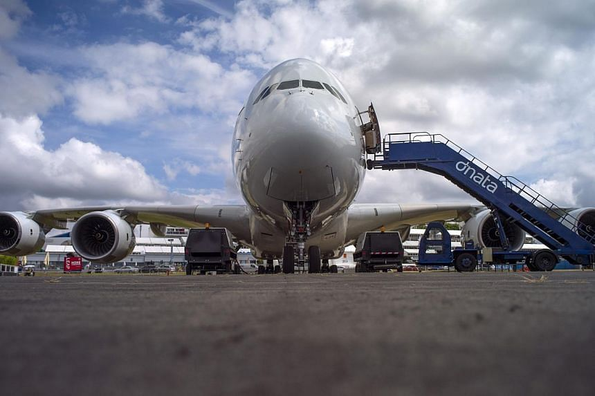 An Airbus Industrie A380 aircraft stands parked at the 2014 Farnborough International Airshow in Farnborough, southern England on July 13, 2014. European planemaker Airbus kicked off the Farnborough Airshow on Monday with confirmation it would s