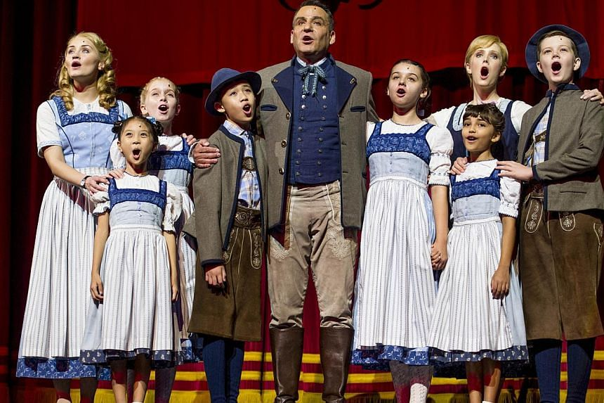 Andre Schwartz and Bethany Dickson playing Captain von Trapp (centre) and Maria (second from left, back row) in the ongoing musical The Sound Of Music at Marina Bay Sands Theatres. Together with them, as the von Trapp children, are (from left) Carmen