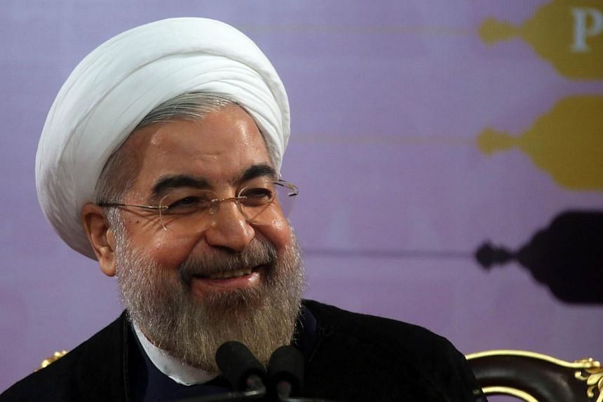 Iranian President Hassan Rouhani speaks during a press conference in the capital Tehran on June 14, 2014.Iran's President Hassan Rouhani should be trusted over Teheran's nuclear programme, but he must be judged on his actions not words, British
