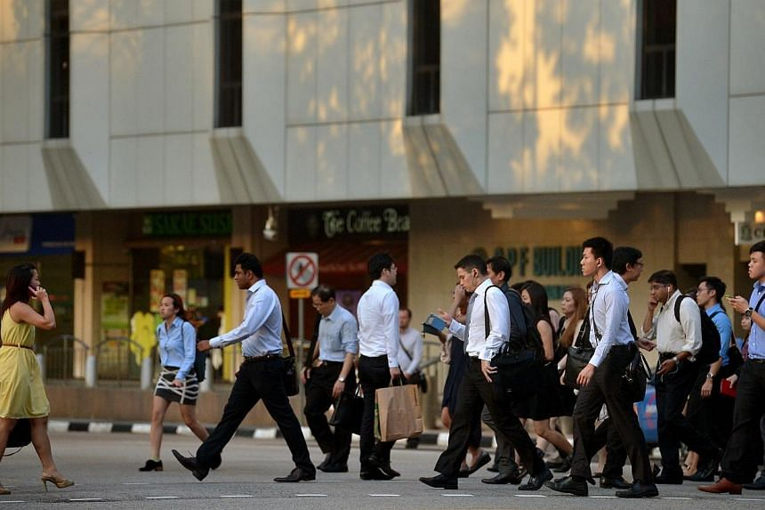 Office workers in the central business district (CBD). A national jobs bank was officially launched on Monday by the Singapore Workforce Development Agency (WDA), listing more than 16,000 positions. -- PHOTO: ST FILE