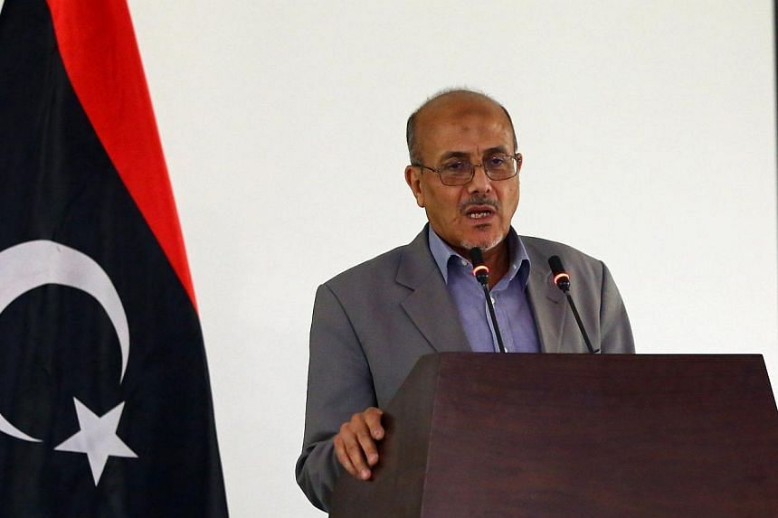 Libyan government's spokesman Ahmad Lamen holds a press conference in the capital Tripoli on July 13, 2014, as deadly clashes rage around the country's main international airport.The United Nations said on Sunday it had temporarily relocated so
