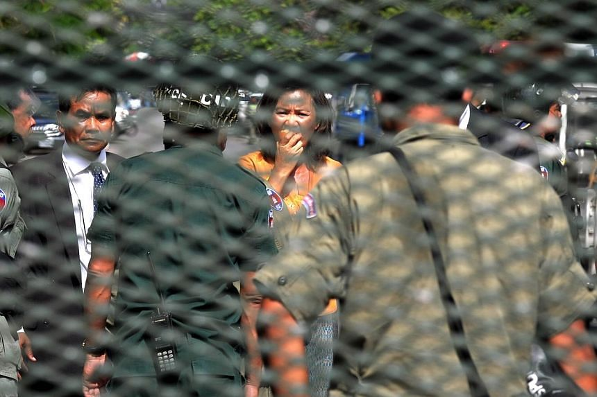 MP-elect and Senior member of the opposition Cambodia National Rescue party, Mu Sochua (Centre) is detained by police officials during a protest calling for authorities to open Freedom Park in Phnom Penh on July 15, 2014. -- PHOTO: AFP