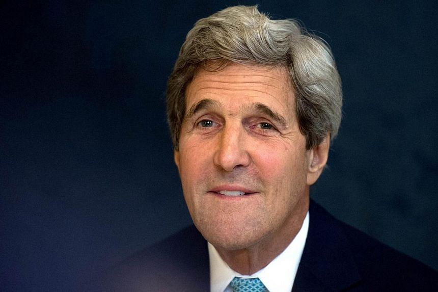 US Secretary of State John Kerry attends a meeting with German Foreign minister at the Coburg Palais in Vienna, on July 13, 2014, during talks of foreign ministers from the six powers negotiating with Tehran on its nuclear program. MrKerry has
