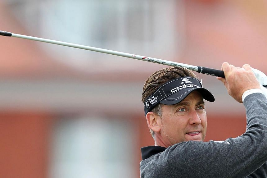 British golfer Ian Poulter drives from the fourth tee box during a practice round the Royal Liverpool Golf Course in Hoylake, north-west England on July 14, 2014. -- PHOTO: AFP