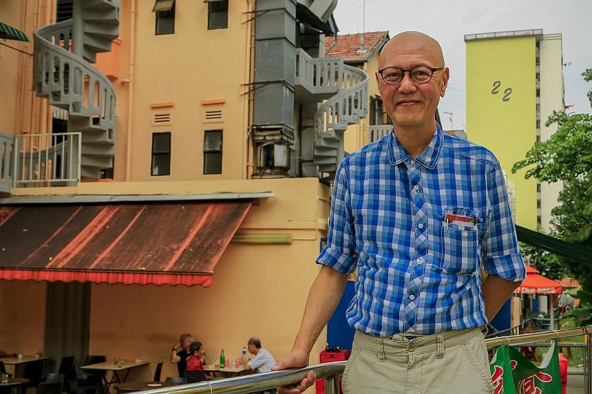 Retiree James Seah standing in front of the MCA (Malayan Chinese Association) shophouses, the only building structures that survived the 1961 Bukit Ho Swee fire. He will be leading heritage trails in the area. -- PHOTO: DRAMA BOX