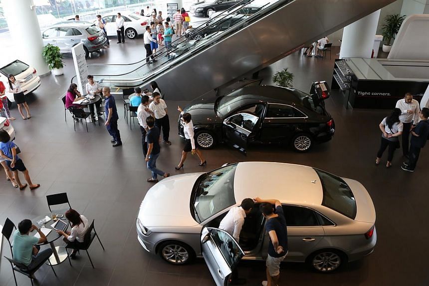 Sales of motor vehicles plummeted 26.8 per cent in May over last year, data released on Tuesday by the Statistics Department showed. -- PHOTO: ST FILE