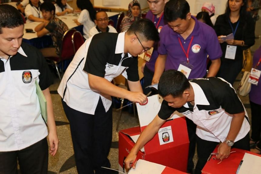Indonesian election officials counting postal votes from Indonesian voters in Singapore at the Indonesian embassy on July 14. -- PHOTO: INDONESIAN EMBASSY IN SINGAPORE
