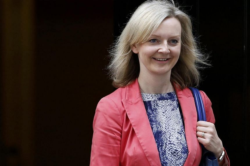 Britain's new Secretary of State for Environment Food and Rural Affairs Liz Truss leaves 10 Downing Street after her appointment in central London,on July 15, 2015.-- PHOTO: REUTERS