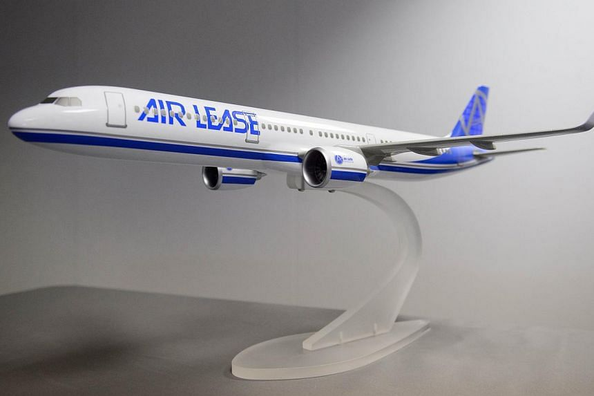 A model of the Airbus A330-900 NEO aircraft is displayed at the Farnborough air show in Farnborough, Hampshire on July 14, 2014.Malaysian airline AirAsia X on Tuesday signed an outline agreement to buy 50 A-330-900neo passenger planes from Airb