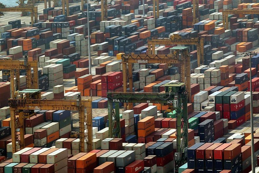 Singapore's non-oil domestic exports are expected to fall on an annual basis in June for the second straight month, a Reuters poll showed on Tuesday, adding to signs of a slowdown in the city-state's manufacturing activity. -- ST PHOTO: LAU FOOK KONG
