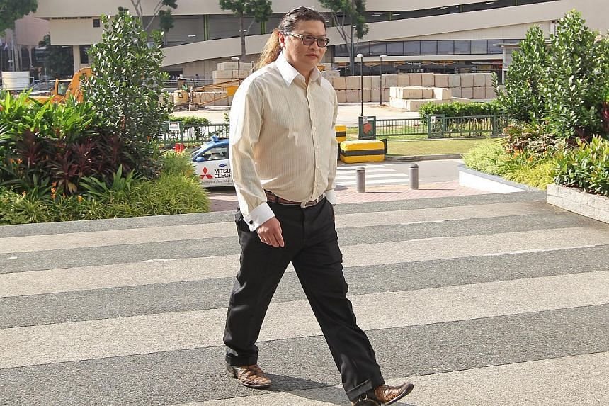 Peter Chua Teck Choon, 39, arrives in State Courts on July 16, 2014. -- ST PHOTO: SEAH KWANG PENG