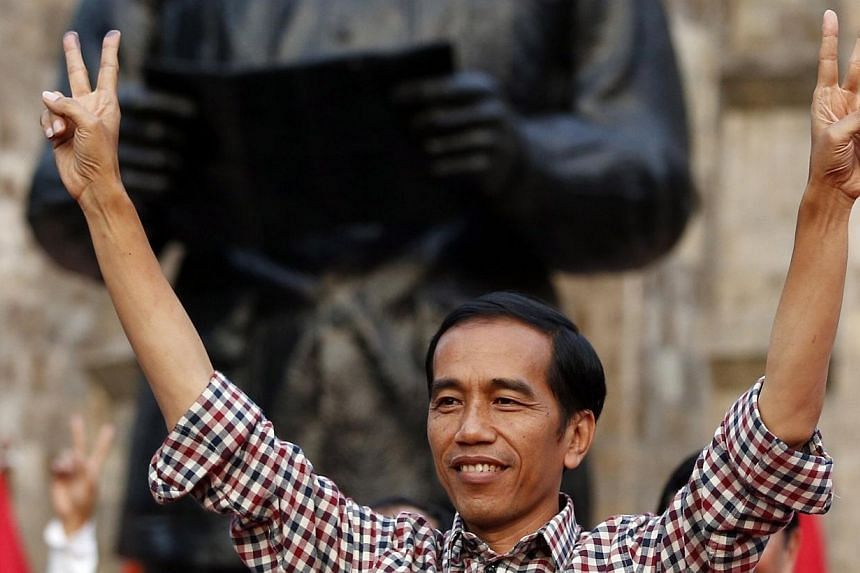"Indonesian presidential candidate Joko ""Jokowi"" Widodo gestures during a rally in Proklamasi Monument Park in Jakarta on July 9, 2014. Jakarta's populist governor looks set to become Indonesia's next president, according to a private tally of 80"