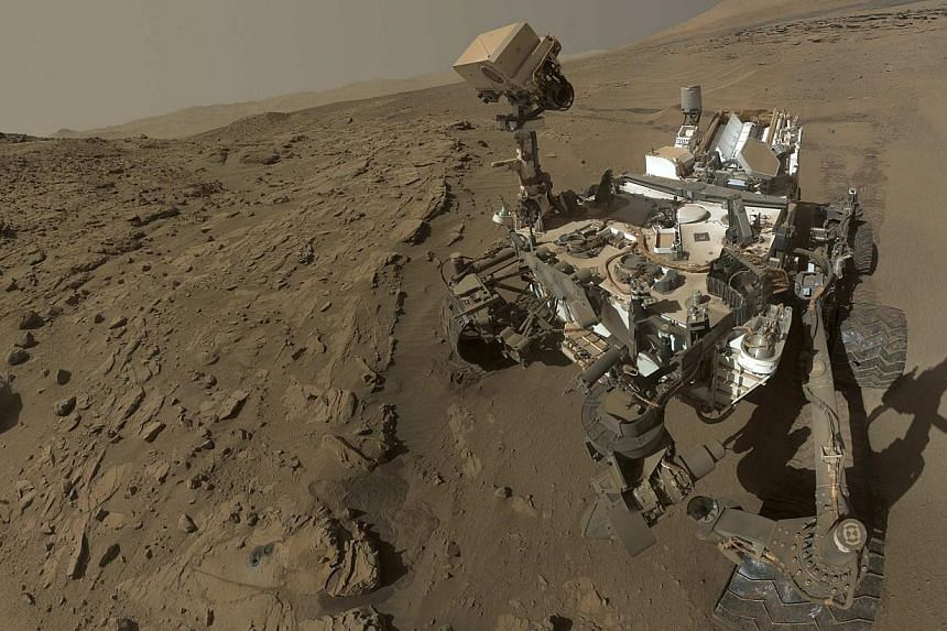 """NASA's Mars Curiosity rover is pictured in this self-portrait where the rover drilled into a sandstone target called """"Windjana"""" on Mars in this undated handout photo.The United Arab Emirates said on Wednesday, July 16, 2014, it planned to send"""