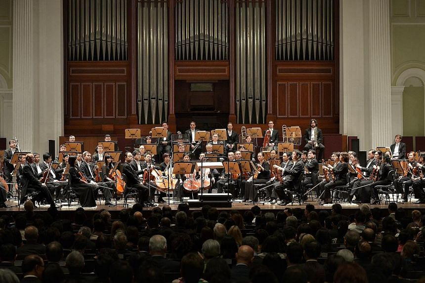 The Singapore Symphony Orchestra (SSO) performing officially for the first time at the refurbished Victoria Concert Hall on July 15, following its four-year restoration.-- ST PHOTO:KUA CHEE SIONG