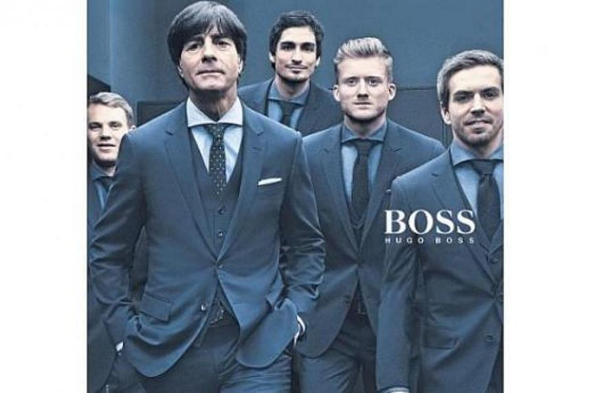 Hugo Boss dresses up the German national football team, which won the World Cup on July 13, 2014. -- PHOTO: HUGO BOSS AD