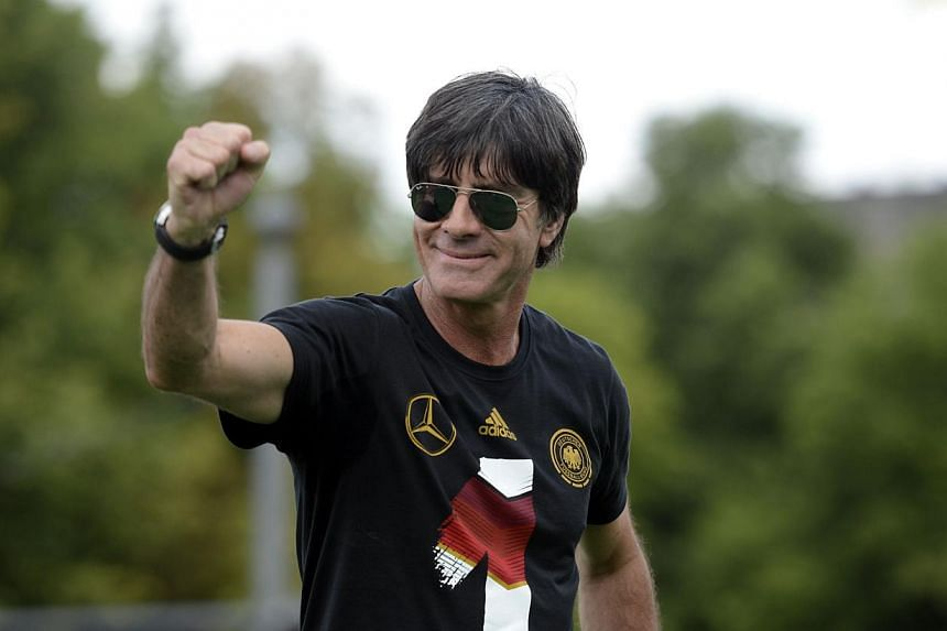 Germany's coach Joachim Loew celebrate their FIFA World Cup title at Berlin's landmark Brandenburg Gate. Germany won their fourth World Cup title, after 1-0 win over Argentina on July 13, 2014 in Rio de Janeiro in the FIFA World Cup Brazil final game