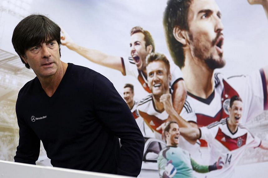 German national soccer coach Joachim Loew arrived for a news conference in St. Martin, northern Italy, May 26, 2014. The German national soccer team's training camp, in preparation for the 2014 World Cup in Brazil, began in St. Martin near Merano on