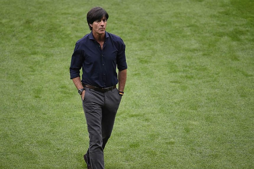 Germany's coach Joachim Loew is pictured before the semi-final football match between Brazil and Germany at The Mineirao Stadium in Belo Horizonte during the 2014 FIFA World Cup on July 8, 2014. -- PHOTO: AFP