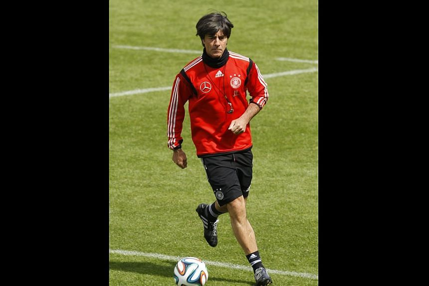 6244f2c2a Germany's national soccer coach Joachim Loew kicks a ball during a training  session in St.