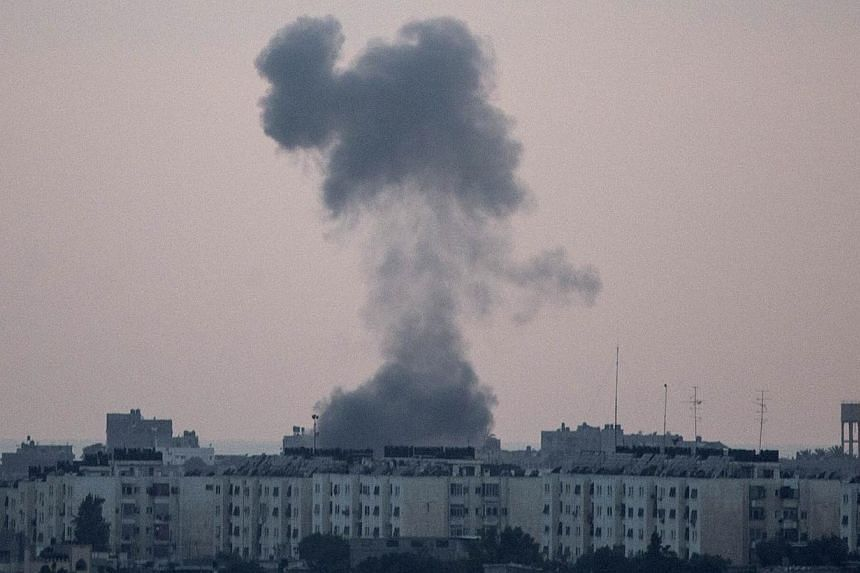 A picture taken from the southern Israeli city of Sderot shows smoke billowing from the Gaza Strip following an Israeli air strike on July 15, 2014.  Israeli warplanes bombed the house of senior Hamas leader Mahmoud al-Zahar on Wednesday, s