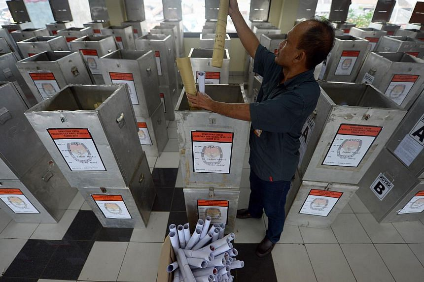 An Indonesian official checking election materials at a local election office in Jakarta on July 7, 2014. Indonesians vote on July 9, in the country's most pivotal presidential election since the downfall of dictator Suharto, with Jakarta governor Jo