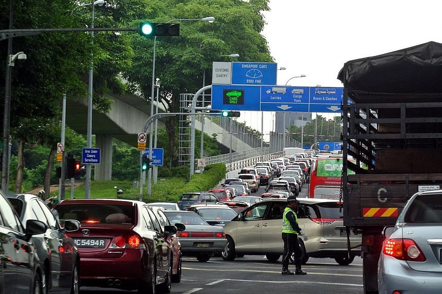 The massive traffic jam heading towards Johor Baru along Woodlands Causeway as seen on June 27, 2014.Malaysian Prime Minister Najib Razak has announced that the government has decided to implement the Vehicle Entry Permit fee for all foreign ve