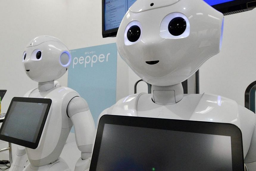 """This picture taken on June 28, 2014 shows Japanese mobile communication giant Softbank's humanoid robot """"Pepper"""" displayed at a high-tech gadgets exhibition in Tokyo.A wise-cracking humanoid robot unveiled in Tokyo last month is said to be able"""