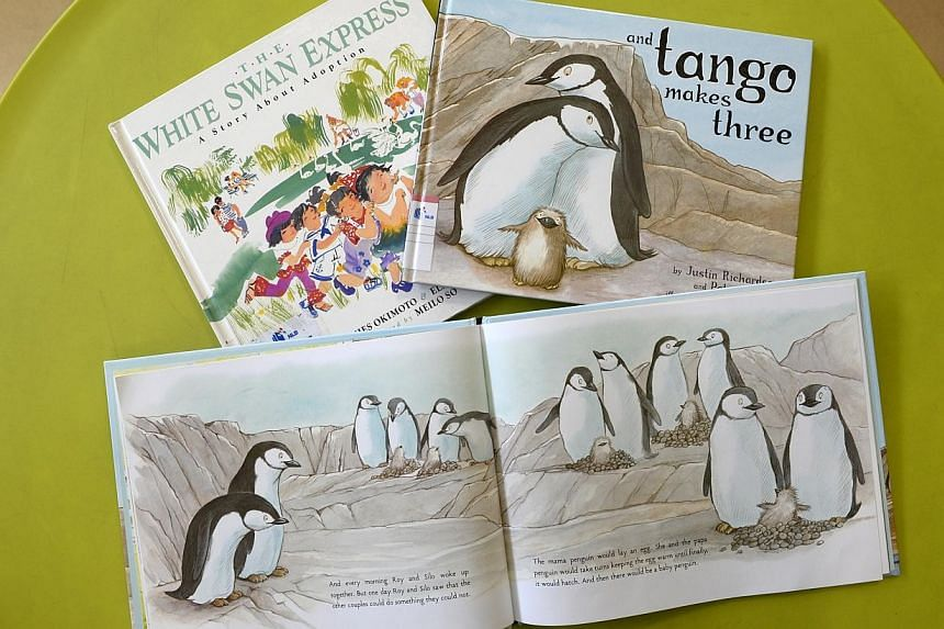 Two of the three children's titles - And Tango Makes Three (bottom and right) and The White Swan Express: A Story About Adoption (left), recently removed by the National Library Board (NLB).Three judges - T. Sasitharan, Romen Bose and Robin Hem