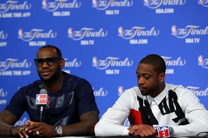 LeBron James #6 and Dwyane Wade #3 of the Miami Heat speak to the media following a 104-87 loss in Game Five of the 2014 NBA Finals at the AT&T Center on June 15, 2014 in San Antonio, Texas. Dwyane Wade will stay with the Miami Heat to aid t