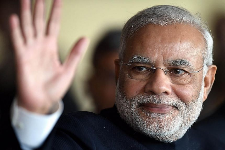 India's Prime Minister Narendra Modi waves while leaving the BRICS-UNASUR Summit at Itamaraty Palace in Brasilia, Brazil on July 16, 2014.The United States said on Wednesday, July 16, 2014, that top Cabinet members will visit India in coming we