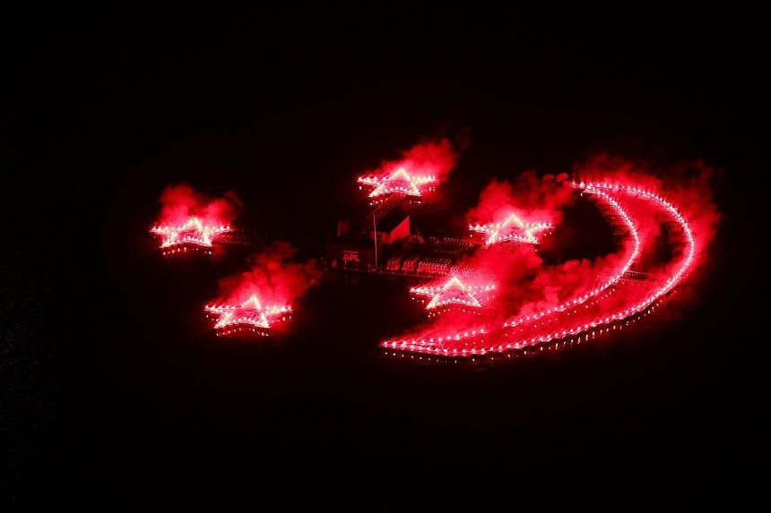 """A """"birthday cake"""" to the nation made up of fireworks in the shape of the Crescent Moon and Five Stars in the middle of the Marina Bay. -- PHOTO:NDP 2014 EXECUTIVE COMMITTEE"""