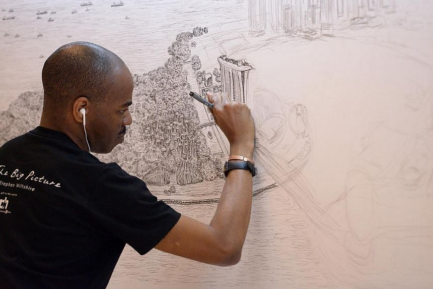 British artist Stephen Wiltshire (left) starting on his sketch of the Singapore cityscape at Paragon yesterday as members of the public watched him work. The first thing he drew on the 4m by 1m canvas was the outline of the iconic Marina Bay Sands (a