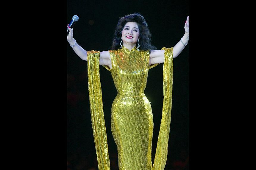 Paula Tsui is known for her husky voice as well as her tiny waist and flamboyant gowns. -- PHOTO: APPLE DAILY
