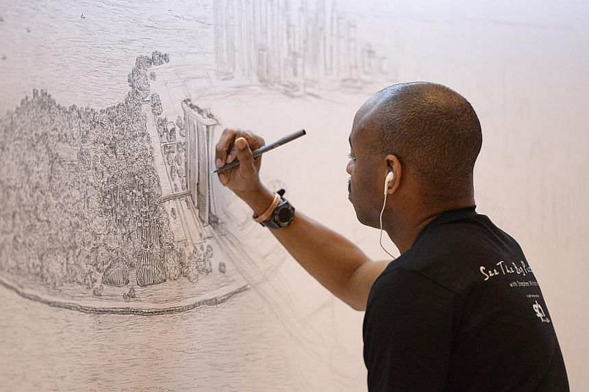 British architectural artist Stephen Wiltshire, who is an autistic savant, has been commissioned by SPH to draw Singapore's cityscape for SPH's 30th anniversary. Drawing will be given to Singapore for 50th birthday. -- ST PHOTO: DESMOND WEE