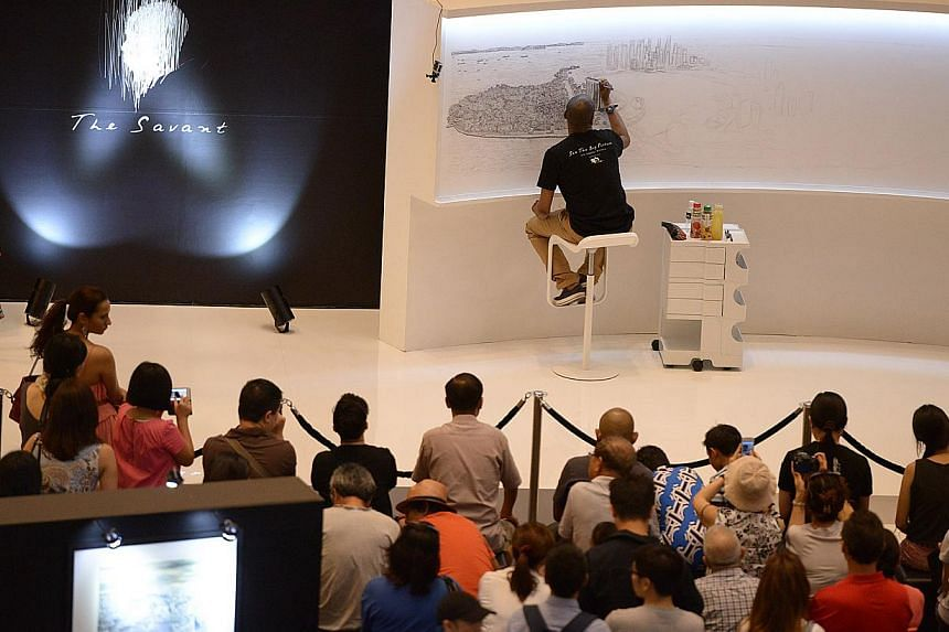 British architectural artist Stephen Wiltshire, who is an autistic savant, has been commissioned by SPH to draw Singapore's cityscape for SPH's 30th anniversary. -- ST PHOTO: DESMOND WEE