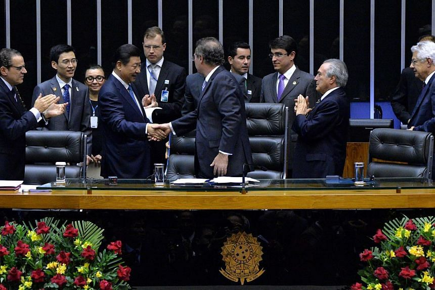Chinese President Xi Jinping (third from left) is greeted at the Congress in Brasilia, on July 16, 2014. -- PHOTO: AFP