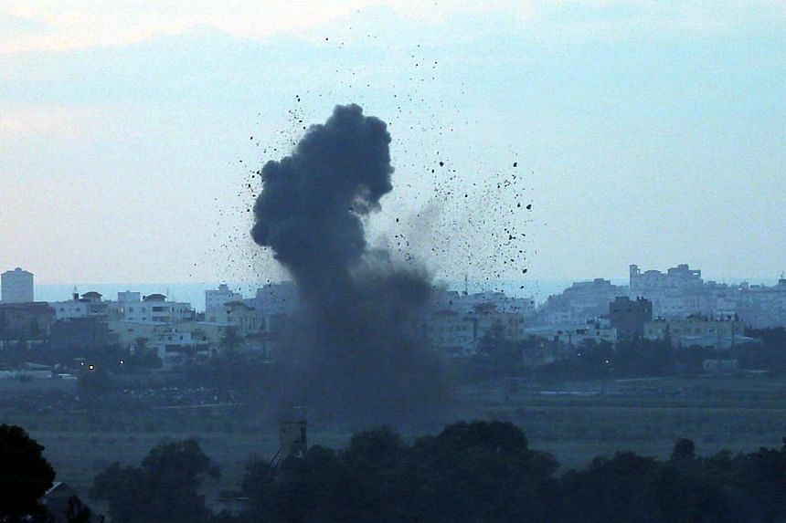 Smoke rises after an explosion in the Gaza Strip on July 16, 2014.A five-hour humanitarian truce agreed by Israel and Hamas came into force on Thursday, hours after the Israeli military said it fought Palestinian gunmen who infiltrated from Gaz