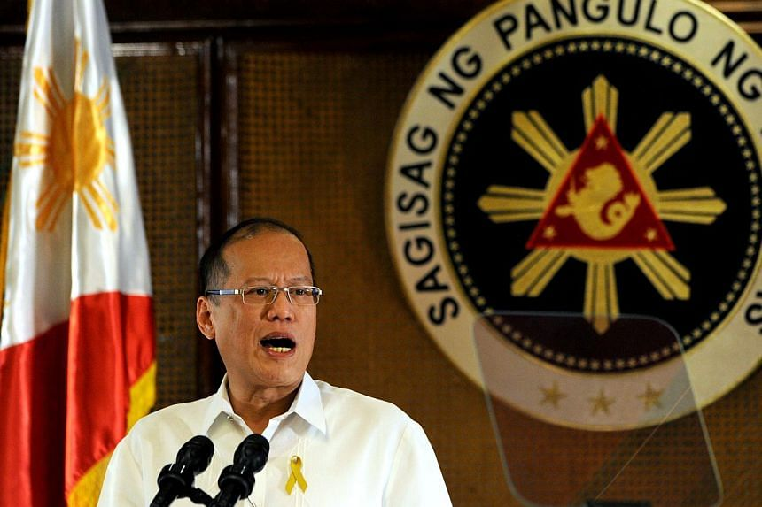 Philippine President Benigno Aquino addresses the nation in a televised speech at Malacanang Palace in Manila on July 14, 2014.Philippine President Benigno Aquino told his country's neighbours on Thursday, July 17, 2014 that efforts to mo