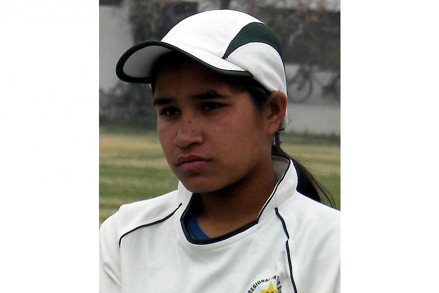 This photograph taken on February 17, 2012 shows female Pakistani cricketer Halima Rafique posing for a photograph at a local cricket stadium in Multan. A female Pakistani cricketer who committed suicide by drinking acid was under extreme stress