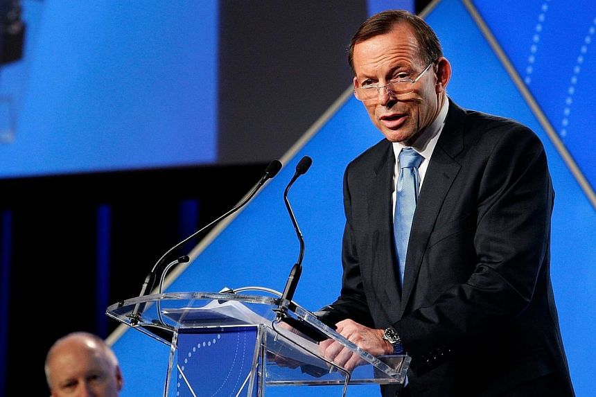 Australian Prime Minister Tony Abbott delivers his keynote speech during the B20 Summit in Sydney on July 17, 2014. Over 350 business leaders have gathered in Sydney for the 2014 B20 Summit to discuss and determine policy recommendations ahead of the