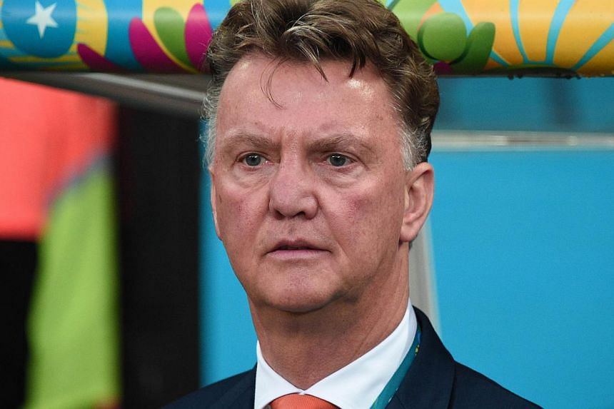 Louis van Gaal started a new era at Manchester United on Wednesday, July 16, 2014, as the Dutch manager arrived for his first day in charge of the fallen giants. -- PHOTO: AFP