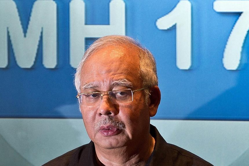 Malaysia's Prime Minister Najib Razak addresses a press conference at a hotel in Sepang, ouside Kuala Lumpur, on July 18, 2014, after Malaysia Airlines flight MH17 carrying 298 people from Amsterdam to Kuala Lumpur crashed in eastern Ukraine.Ma